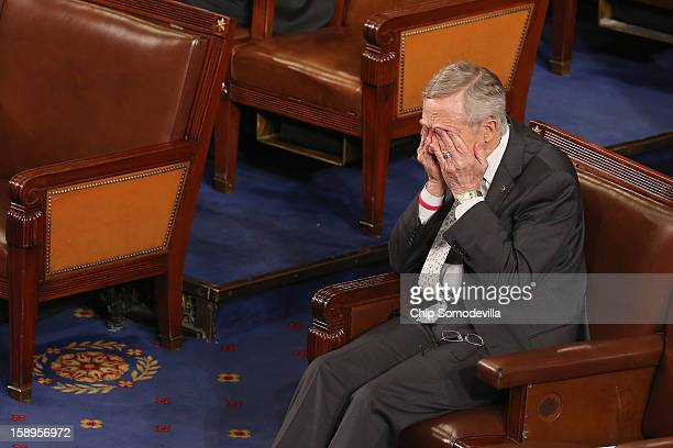 Senate Majority Leader Harry Reid rubs his eyes during the counting of the Electorial College votes from the 50 states in the House of...