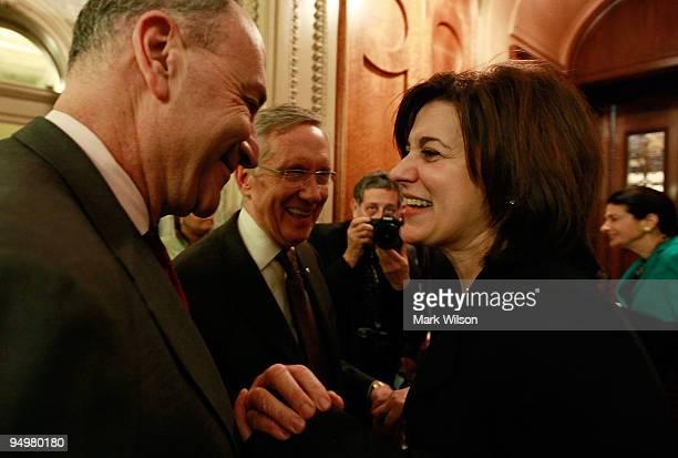 Senate Majority Leader Harry Reid Sen Charles Schumer and Victoria Reggie Kennedy react after the Senate passed procedural vote on health care reform...