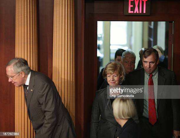 Senate Majority Leader Harry Reid Sen Tammy Baldwin and Sen Jeff Merkley and other Democrats arrive for a news conference before the final passage of...