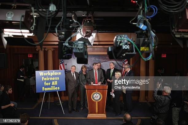 Senate Majority Leader Harry Reid Sen Tammy Baldwin Sen Jeff Merkley Sen Richard Durbin Sen Tom Harkin Sen Patty Murray and Sen Charles Schumer hold...