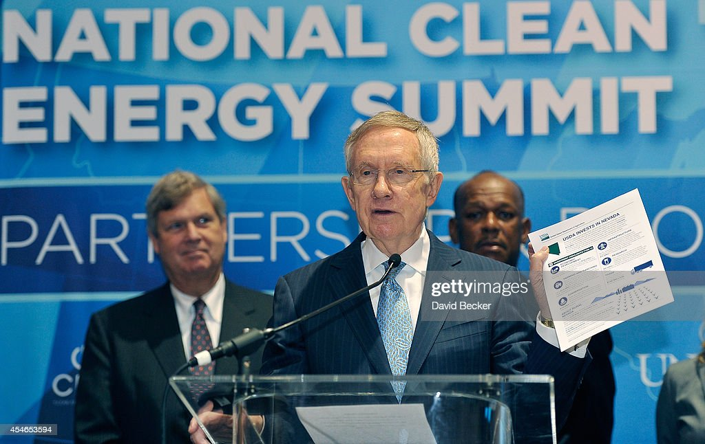 U.S. Senate Majority Leader Harry Reid (D-NV) (C) speaks as Agriculture Secretary Tom Vilsack (L) and President of U.S. Operations for UPS Myron Gray look on during a news conference at the National Clean Energy Summit 7.0 at the Mandalay Bay Convention Center on September 4, 2014 in Las Vegas, Nevada.
