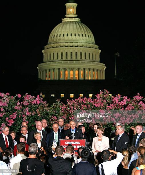 Senate Majority Leader Harry Reid speaks as US Speaker of the House Rep Nancy Pelosi Sen Charles Schumer and other members of Congress gather during...