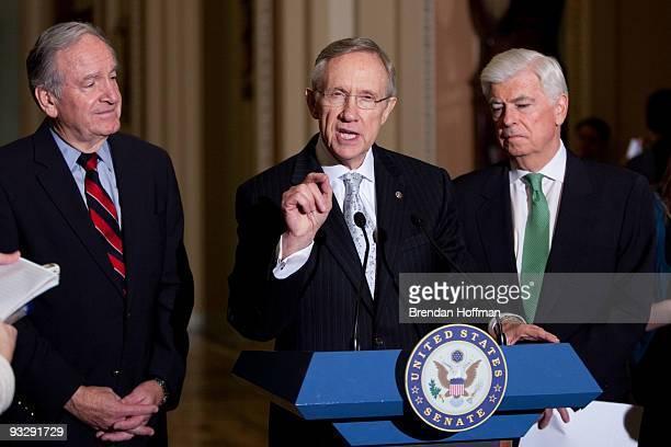 Senate Majority Leader Harry Reid speaks at a news conference as Sen Chris Dodd and Sen Tom Harkin look on following the Senate's cloture vote on...