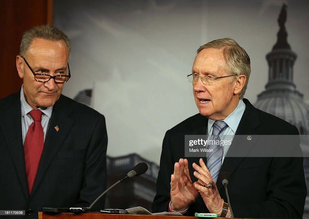Senate Majority Leader Harry Reid (D-NV) (R) speaks during a news conference with Sen. Chuck Schumer (D-NY) on Capitol Hill, September 19, 2013 in Washington, DC. Leader Reid spoke about the continuing resolution and Republican efforts to defund Obamacare.