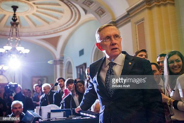 US Senate Majority Leader Harry Reid speaks to the media on Capitol Hill in Washington Congress and the White House are seeking a way to avoid a...