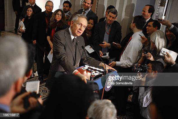 Senate Majority Leader Harry Reid talks to reporters after the Senate Democrats' weekly policy luncheon at the US Capitol December 11 2012 in...
