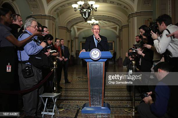 Senate Majority Leader Harry Reid talks to reporters after the weekly Senate Democratic policy committee luncheon at the US Capitol March 5 2013 in...