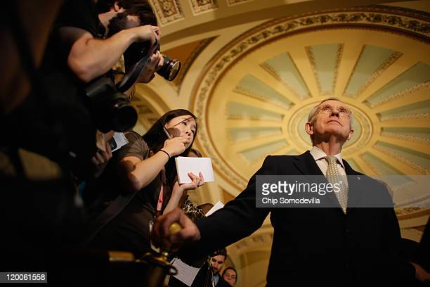 Senate Majority Leader Harry Reid talks with reporters after a Senate Democratic caucus meeting in the U.S. Capitol July 29, 2011 in Washington, DC....
