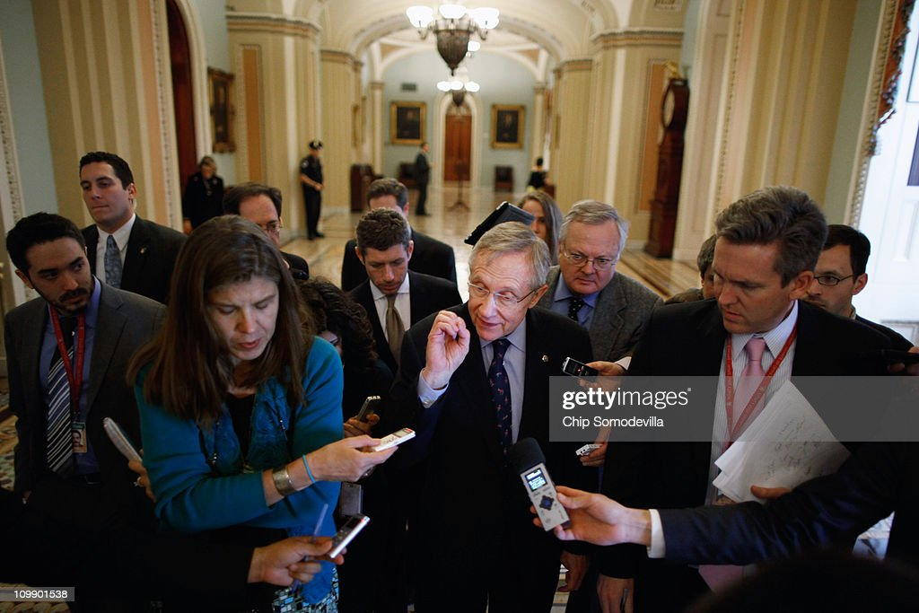 Senate Majority Leader Harry Reid (R-NV) (C) talks with reporters after leaving Senate Minority Whip Jon Kyl's (R-AZ) office in the U.S. Capitol March 9, 2011 in Washington, DC. The Senate failed to pass legislation approved last month by the House that would cut $57 billion from the federal budget. Now, lawmakers must agree to another spending bill by March 18 when the current temporary budgetary measure expires.