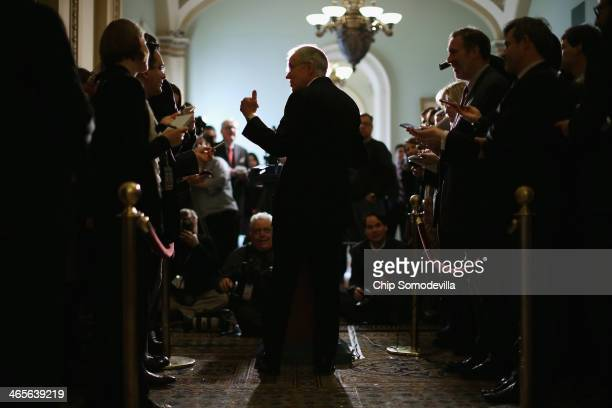 Senate Majority Leader Harry Reid talks with reporters after the weekly Senate Democratic Policy Luncheon at the US Capitol January 28 2014 in...