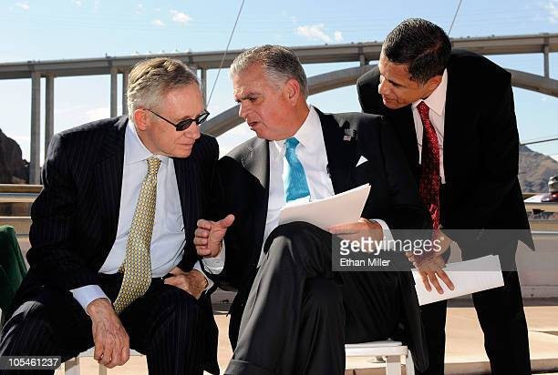 US Senate Majority Leader Harry Reid US Transportation Secretary Ray LaHood and Federal Highway Administration Administrator Victor Mendez attend the...