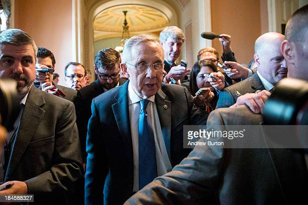 Senate Majority Leader Harry Reid walks through the Capitol building on October 14 2013 in Washington DC As Democratic and Republican leaders...