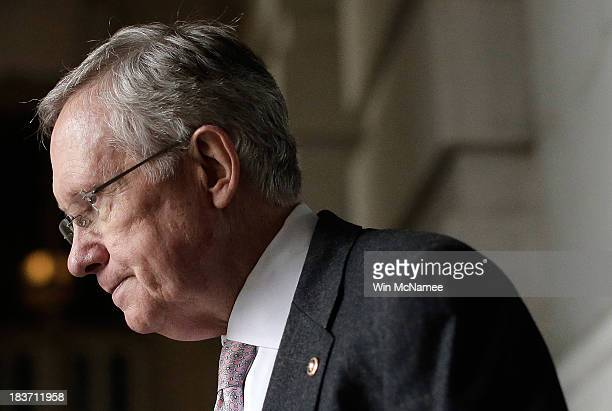 Senate Majority Leader Harry Reid walks to an event with Democratic senators on the steps US Capitol October 9 2013 in Washington DC The US...