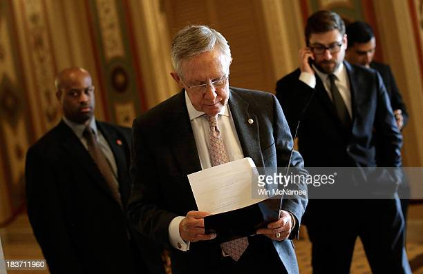 Senate Majority Leader Harry Reid walks to an event with Democratic senators on the steps of the US Capitol October 9 2013 in Washington DC The US...