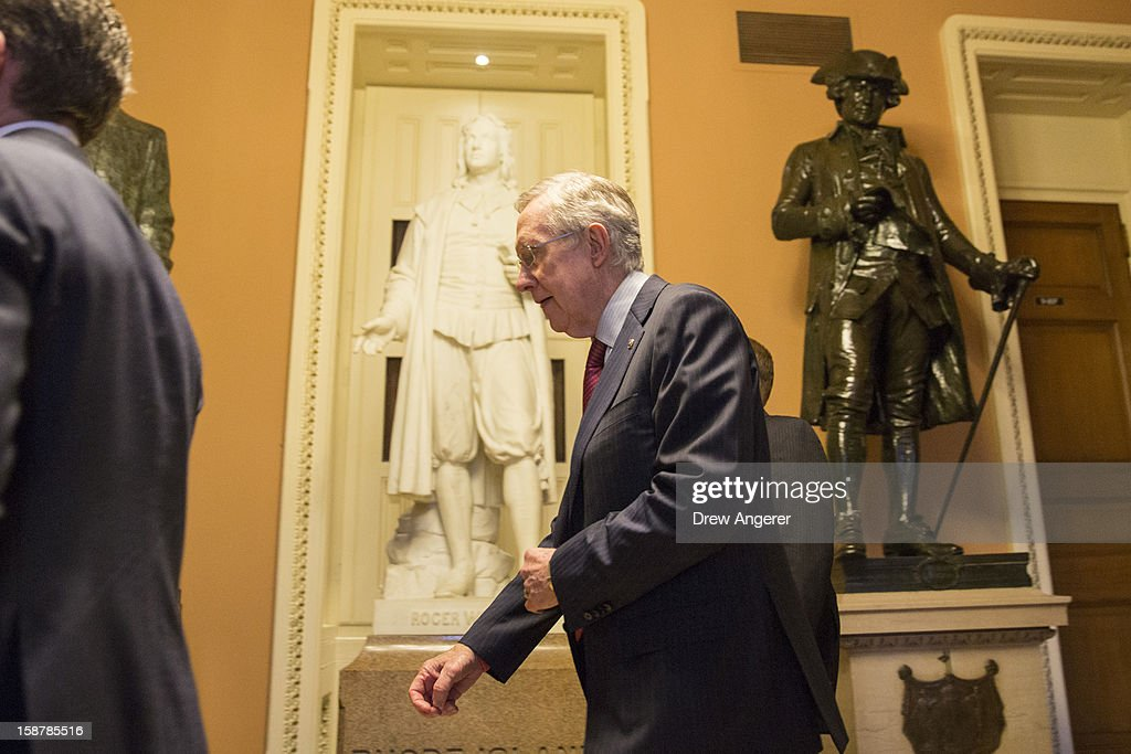 Senate Majority Leader Harry Reid (D-NV) walks to his office after meeting with U.S. President Obama and other Congressional leaders at the White House, on Capitol Hill December 28, 2012 in Washington, DC. The Senate was back in session on Friday to deal with the looming 'fiscal cliff' issue.