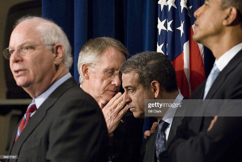 Senate Majority Leader Harry Reid whispers to Sen. Russell Feingold, D-Wisc., as freshman Sen. Ben Cardin speaks during a news conference on Senate ethics reform legislation in the Senate TV studio on Monday Jan. 8, 2006. Sen. Barack Obama, D-Ill., stands to the right.