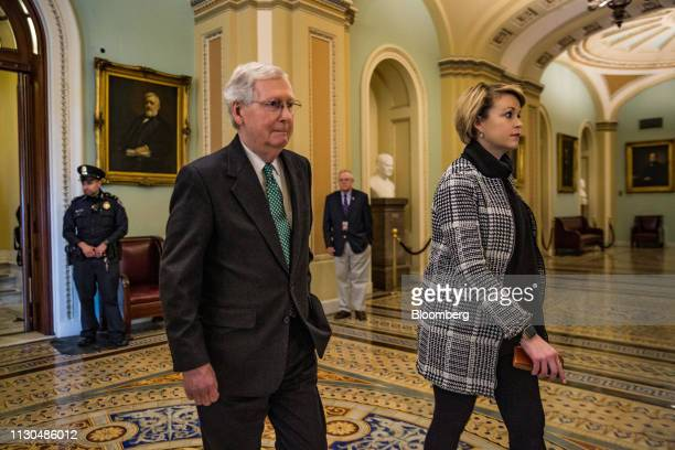Senate Majority Leader Mitch McConnell a Republican from Kentucky departs following a vote on the national emergency declaration in Washington DC US...