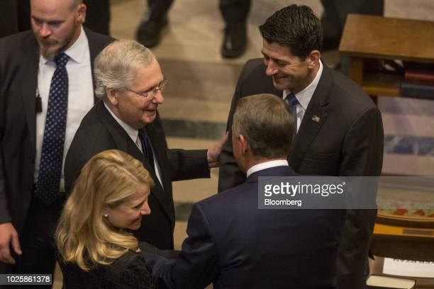 Senate Majority Leader Mitch McConnell, a Republican from Kentucky, center left, and House Speaker Paul Ryan, a Republican from Wisconsin, center...