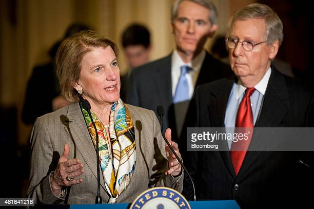 Senate Majority Leader Mitch McConnell a Republican from Kentucky right looks on as Senator Shelley Moore Capito a Republican from West Virginia...