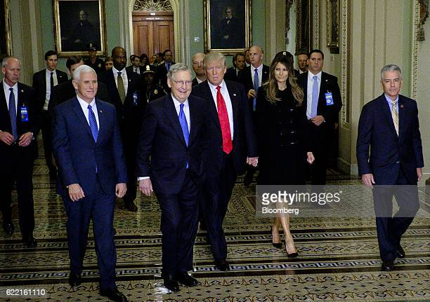 Senate Majority Leader Mitch McConnell a Republican from Kentucky second left escorts US Presidentelect Donald Trump center US Vice Presidentelect...