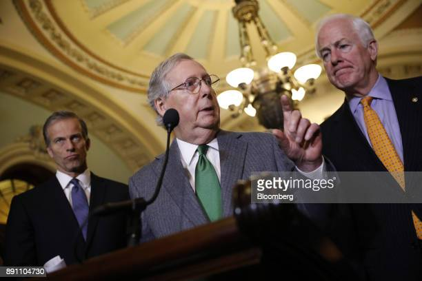Senate Majority Leader Mitch McConnell a Republican from Kentucky center speaks while Senator John Cornyn a Republican from Texas right and Senator...