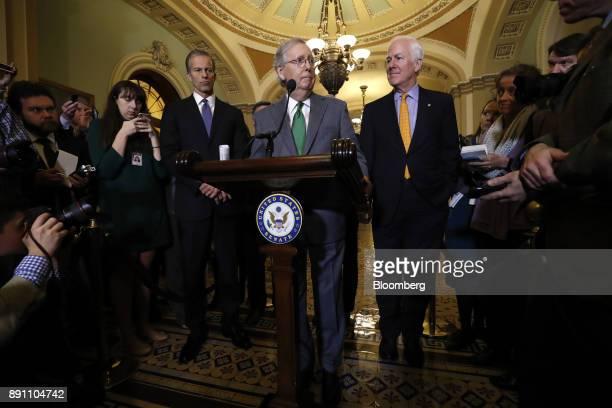 Senate Majority Leader Mitch McConnell a Republican from Kentucky center Senator John Cornyn a Republican from Texas right and Senator John Thune a...
