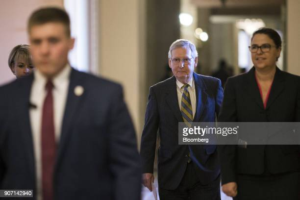 Senate Majority Leader Mitch McConnell a Republican from Kentucky center walks to the Senate Floor at the US Capitol in in Washington DC US on Friday...