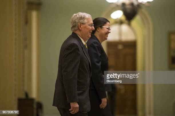 Senate Majority Leader Mitch McConnell a Republican from Kentucky left walks to the Senate Floor at the US Capitol in Washington DC US on Friday Jan...