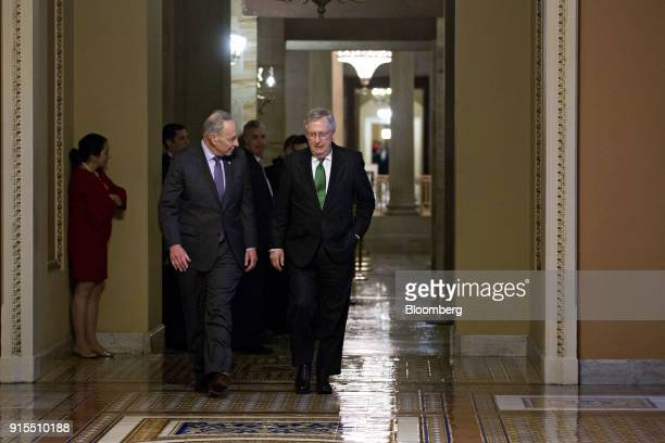 Senate Majority Leader Mitch McConnell a Republican from Kentucky right and Senate Minority Leader Chuck Schumer a Democrat from New York walk...