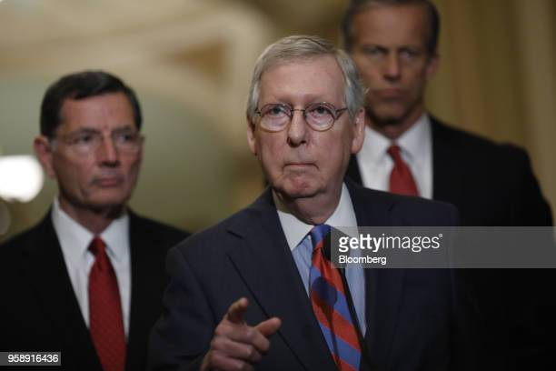 Senate Majority Leader Mitch McConnell a Republican from Kentucky center speaks during a news conference after a Senate Republican weekly luncheon...