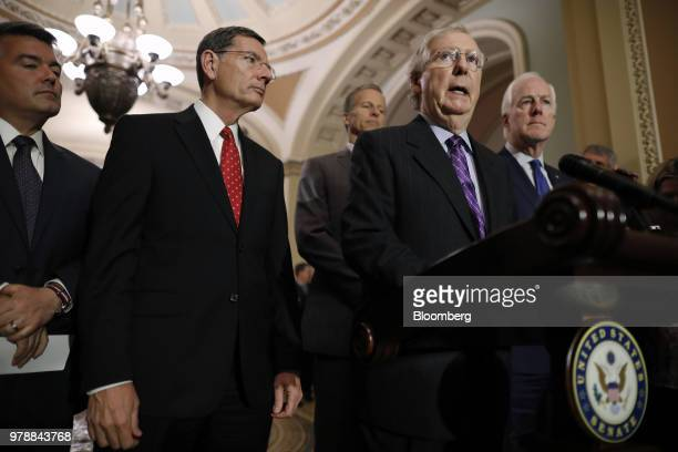 Senate Majority Leader Mitch McConnell a Republican from Kentucky right speaks during a news conference following a Senate weekly luncheon meeting at...