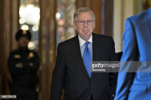 Senate Majority Leader Mitch McConnell a Republican from Kentucky walk to his office at the US Capitol in Washington DC US on Friday April 7 2017...