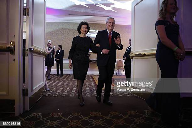 Senate Majority Leader Mitch McConnell and his wife Secretary of Transportation nominee Elaine Chao arrive at the Kentucky Society of Washington's...