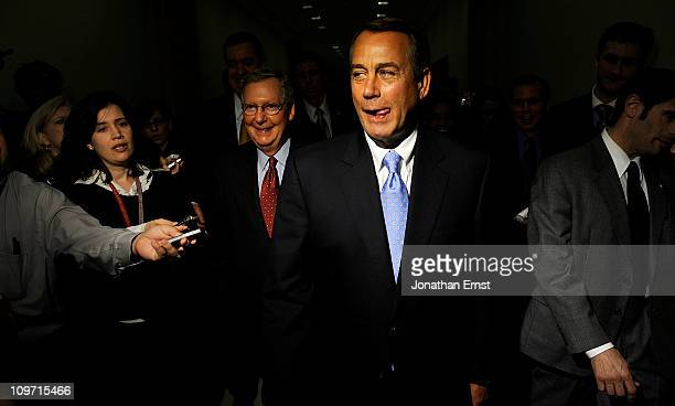S Senate Majority Leader Mitch McConnell and House Speaker John Boehner leave after holding a news conference at the US Capitol on March 2 2011 in...