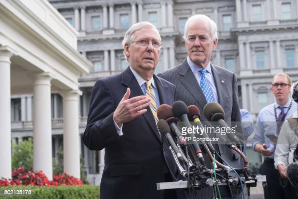 US Senate Majority Leader Mitch McConnell and Majority Whip John Cornyn speak to the press outside the West Wing of the White House after Republican...