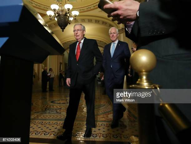 Senate Majority Leader Mitch McConnell and Sen John Cornyn walk up to speak to reporters about the proposed Senate Republican tax bill after...
