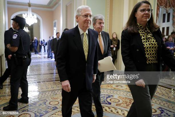 Senate Majority Leader Mitch McConnell and Sen Roy Blunt walk to the Senate Chamber following the Senate Republican policy luncheon at the US Capitol...