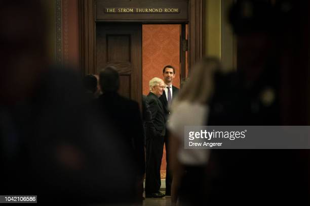 Senate Majority Leader Mitch McConnell and Sen Tom Cotton await fellow GOP Senators for the start of a closeddoor GOP caucus meeting following the...