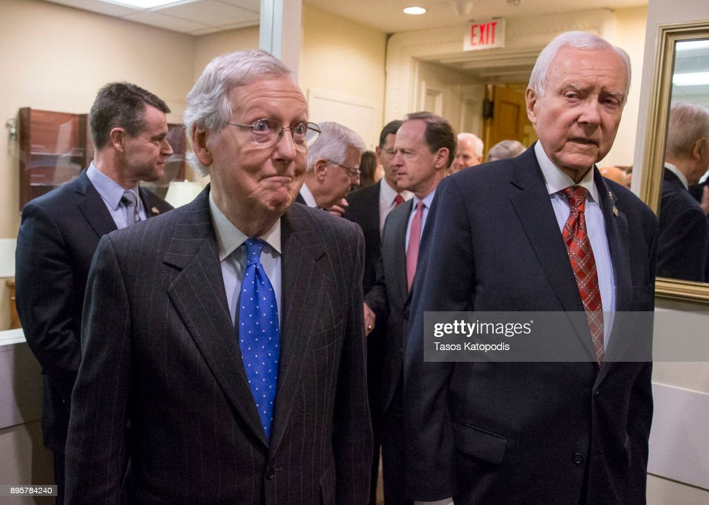 Senate Majority Leader Mitch McConnell (R-KY) and Senate Finance Committee chairman Orrin Hatch (R-UT) arrive at the press conference after the senate vote of the tax reform bill on December 20, 2017 in Washington, DC. The Senate has passed the tax reform bill and it will return to the House of Representatives for final approval.