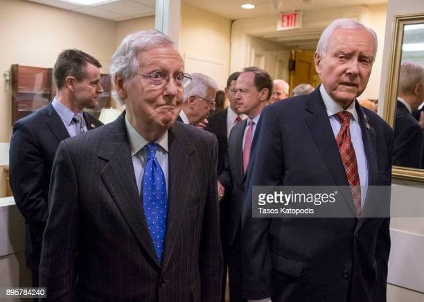 Senate Majority Leader Mitch McConnell and Senate Finance Committee chairman Orrin Hatch arrive at the press conference after the senate vote of the...