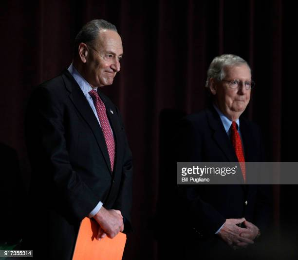 S Senate Majority Leader Mitch McConnell and US Senate Democratic Leader Chuck Schumer stand on the stage together at the University of Louisville's...