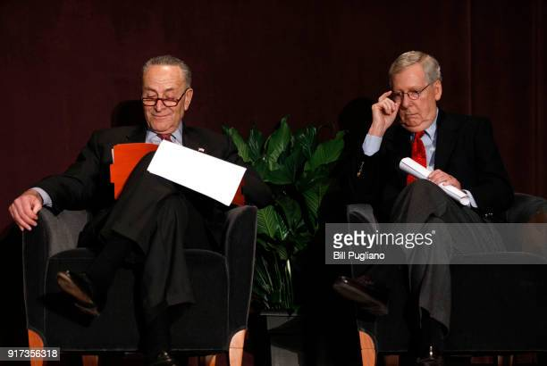 S Senate Majority Leader Mitch McConnell and US Senate Democratic Leader Chuck Schumer wait on the stage together at the University of Louisville's...