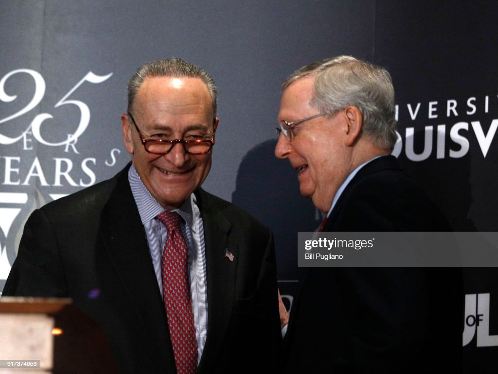 U.S. Senate Majority Leader Mitch McConnell (right) (R-KY) and U.S. Senate Democratic Leader Chuck Schumer (D-NY) shake hands after Shumer delivered a speech and answered questions at the University of Louisville's McConnell Center February 12, 2018 in Louisville, Kentucky. Sen. Schumer spoke at the event as part of the Center's Distinguished Speaker Series, and Sen. McConnell introduced him.
