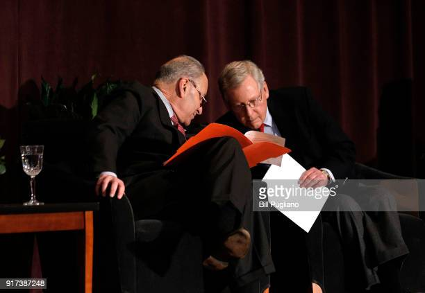 S Senate Majority Leader Mitch McConnell and US Senate Democratic Leader Chuck Schumer wait the stage together at the University of Louisville's...