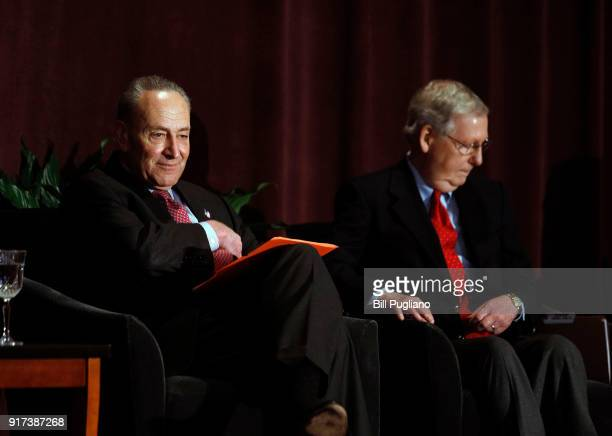 S Senate Majority Leader Mitch McConnell and US Senate Democratic Leader Chuck Schumer wait on stage together at the University of Louisville's...