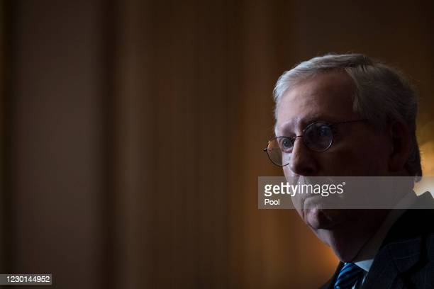 Senate Majority Leader Mitch McConnell answers questions from reporters during a news conference following the weekly meeting with the Senate...
