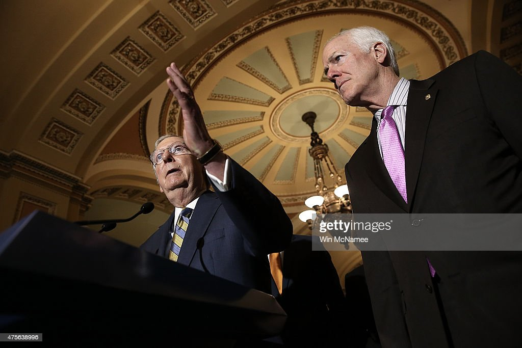 Senate Majority Leader Mitch McConnell (L) (R-KY) answers questions with Sen. John Cornyn (R) (R-TX) at the U.S. Capitol June 2, 2015 in Washington, DC. McConnell spoke following the weekly Republican caucus policy luncheon.