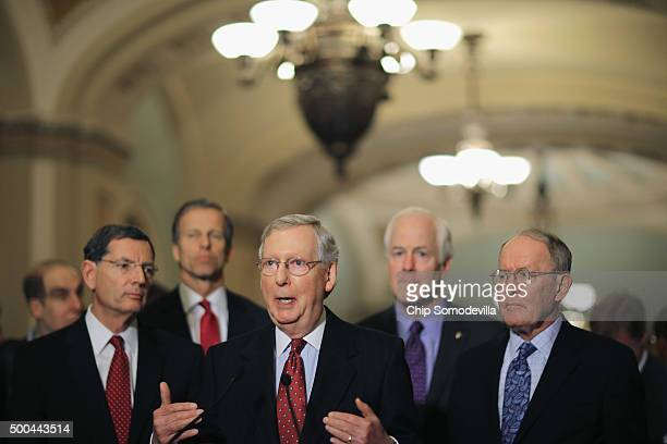 Senate Majority Leader Mitch McConnell answers reporters' questions during a news briefing with Sen. John Barrasso , Sen. John Thune , Sen. John...