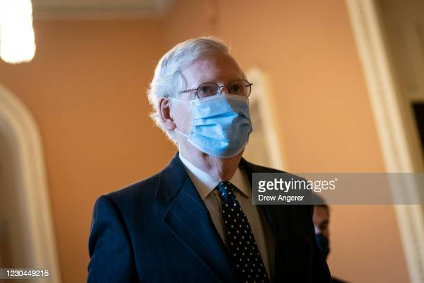 Senate Majority Leader Mitch McConnell arrives at the U.S. Capitol and walks to his office on January 06, 2021 in Washington, DC. Congress held a...