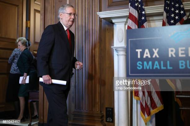 Senate Majority Leader Mitch McConnell arrives for a rally to promote tax reform legislation with fellow Senate GOP leaders and representatives from...
